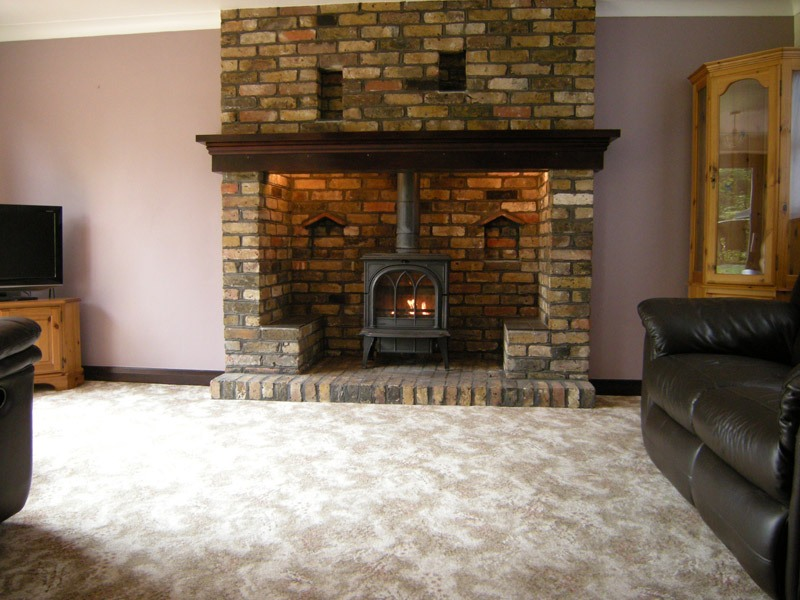 Hardy wood stove on Custom-Fireplace. Quality electric ...
